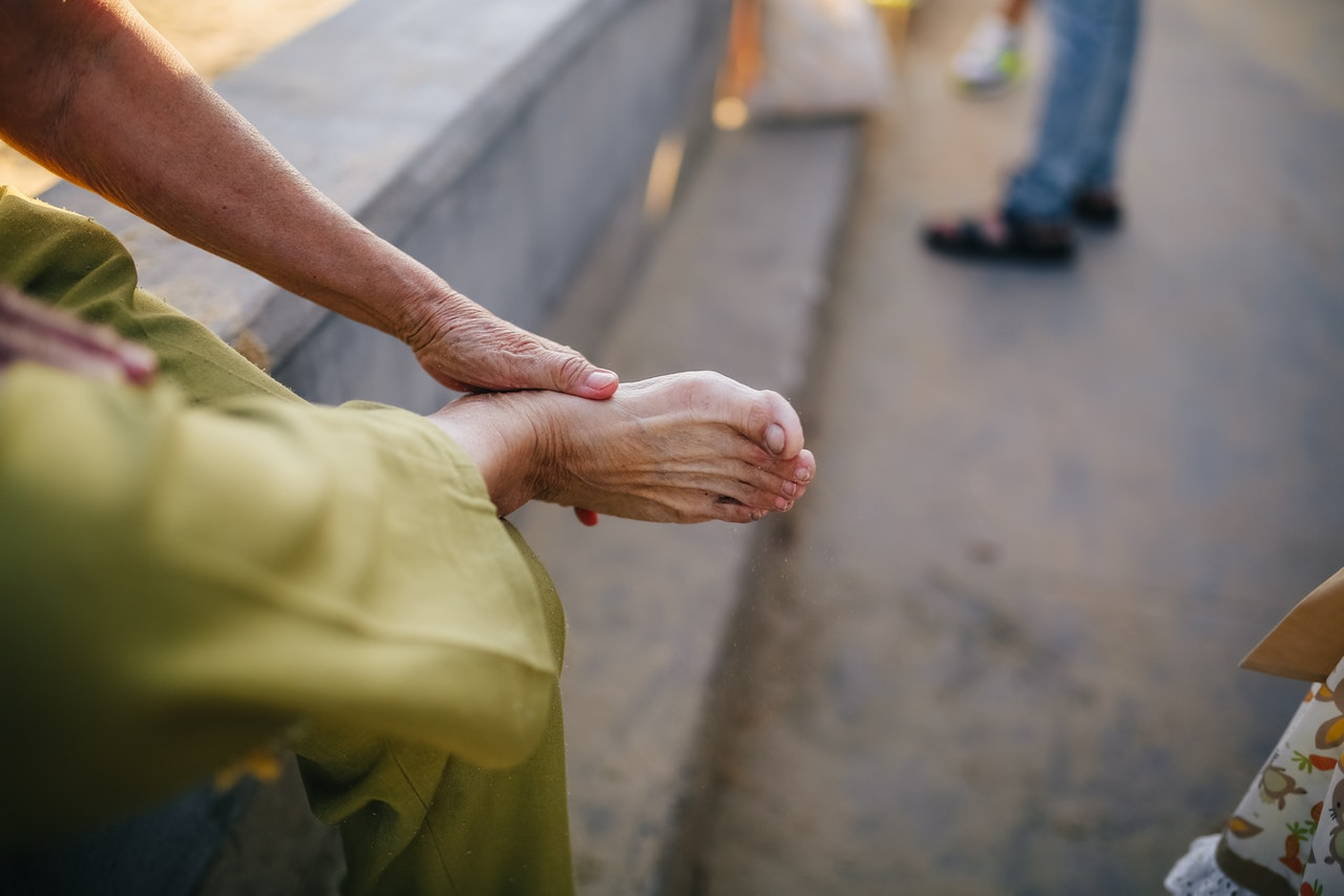 Medical Marijuana patient rubbing foot hurting from Neuropathy